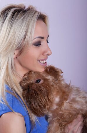 griffon bruxellois: Young woman with a dog breed Griffon Bruxellois