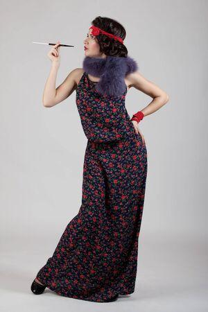 Belle jeune femme dans le style de 1920-1930 Banque d'images - 12022146