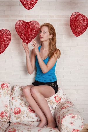 Young woman with red heart in hands, in day Valentine Stock Photo - 12515997