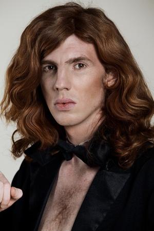 Beautiful, young man with the long, auburn hair photo