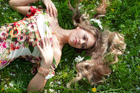 Woman in a summer dress lying on the grass, scattered hair Stock Photo - 13839603