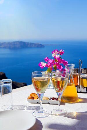 Table above sea for two  Greece, Santorini island photo