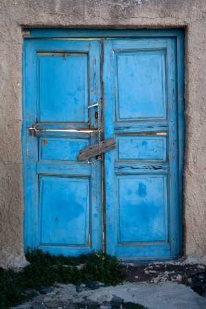 Old door of blue color. Santorini Island, Greece photo