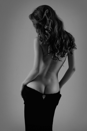 naked woman back:  Beautiful silhouette of a woman with bare back