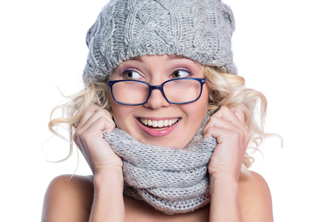 Young woman in a hat, scarf and glasses, isolated on white background photo