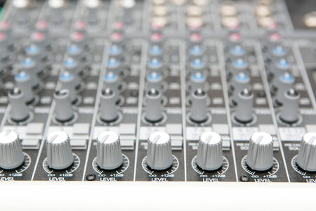 Part audio mixer panel in the studio photo
