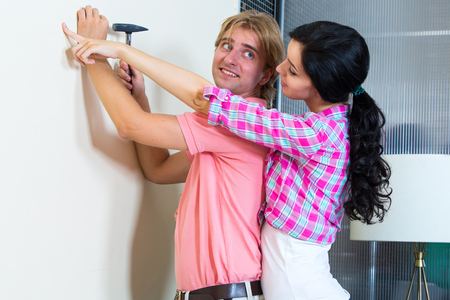 home repairs: Young couple together has small home repairs Stock Photo