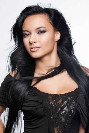 Beautiful young woman with black, long hair photo