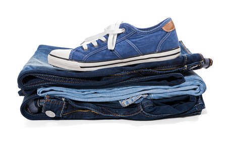 untied: Jeans and blue sneakers isolated on white background