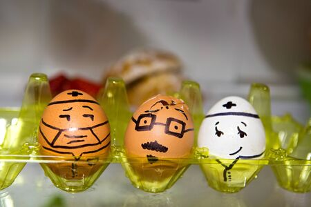 cracked egg: Painted eggs in the fridge, cracked egg and the doctor