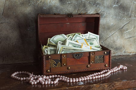 storage box: Storage of cash at home in a box Stock Photo
