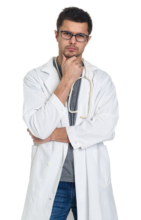 seriousness skill: Young doctor in white uniform and glasses