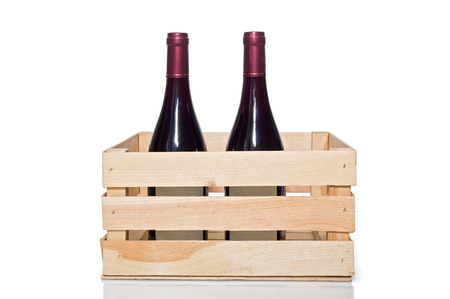 Wine bottle in wooden crate, isolated on white