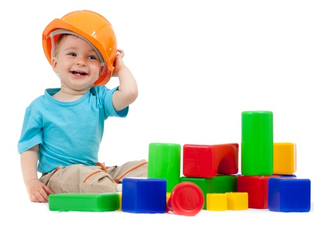 game block: little boy with hard hat and building blocks Stock Photo