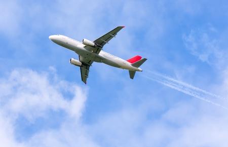 turbulence: airplane on the blue sky Stock Photo