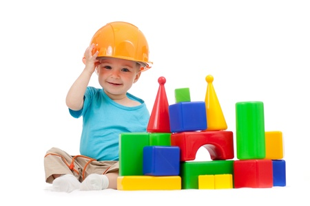 little boy with hard hat and building blocks Stockfoto