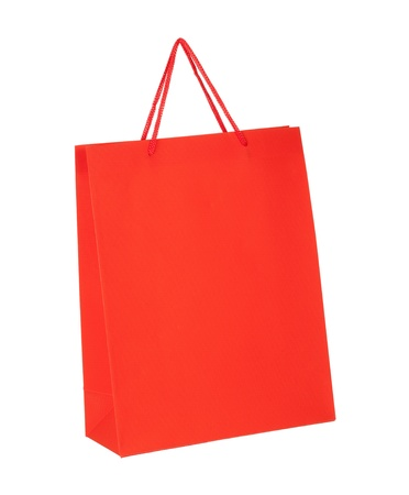 Red shopping paper bag isolated on white background photo