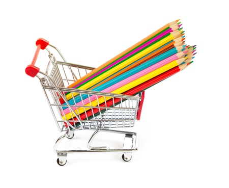color pencils in shopping cart isolated photo