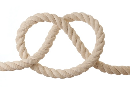 fastening objects: Knot on a rope isolated on white