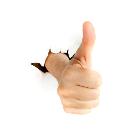 endorsing: Hand with thumb up through a hole in paper