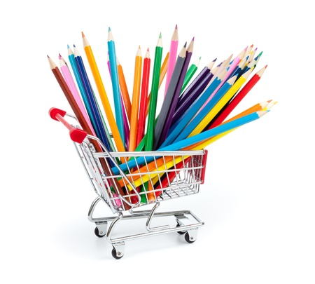 color pencils in shopping cart isolated
