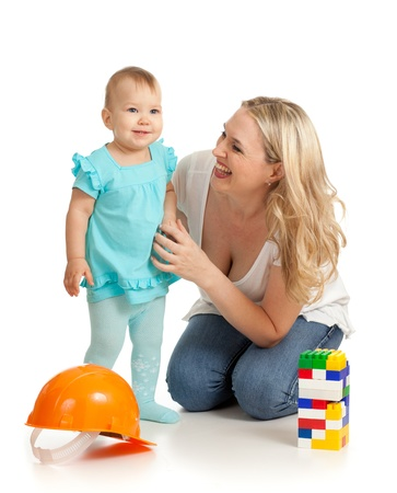 little girl and mother with construction set and hard photo