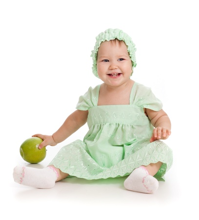baby girl with green apple Stock Photo - 11108173