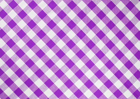 lilac background: light violet checked fabric tablecloth Stock Photo