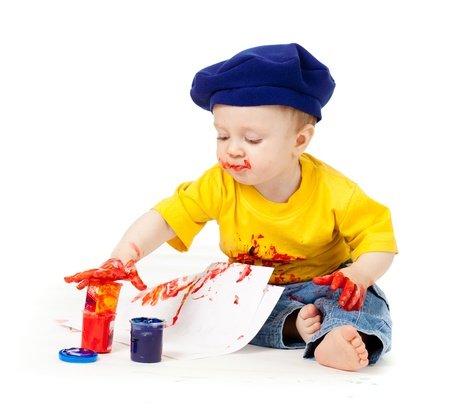 young artist child with paints Stock Photo