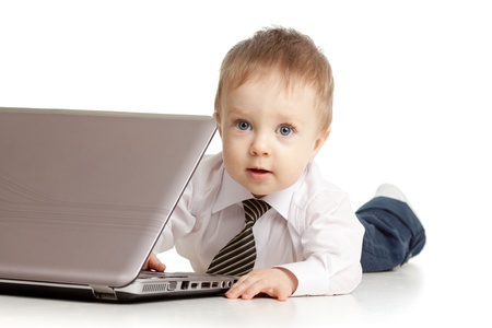 computers and communications: Child using a laptop
