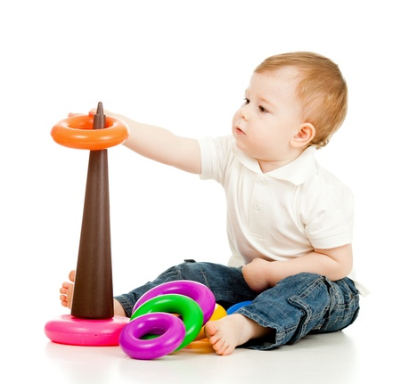 baby play: child playing with color pyramidion Stock Photo