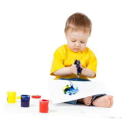spilled paint: Adorable dirty child with paints Stock Photo