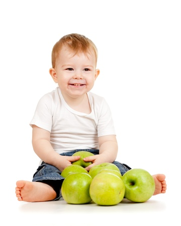pome: Smiling child with green apples