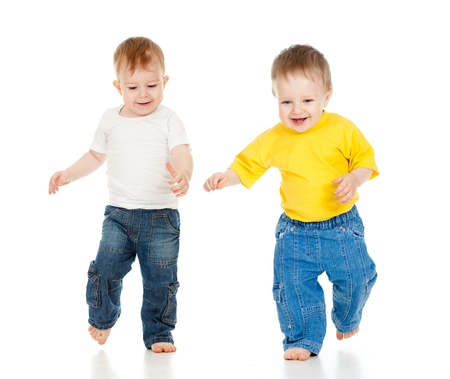 Two little boys playing game and running Stock Photo