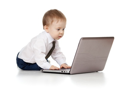 kids writing: Child using a laptop