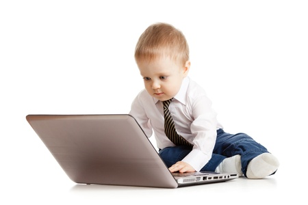 Cute child using laptop photo