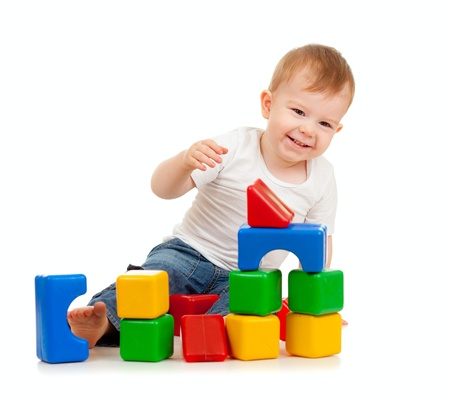 baby playing toy: little boy playing with building blocks