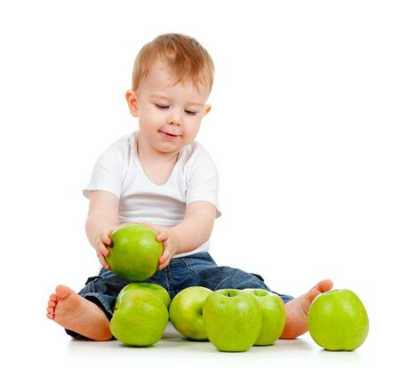 pome: Adorable child with green apples