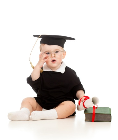 Baby in academician clothes  with roll and book Stock Photo - 11327446