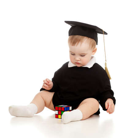 Baby in academician clothes  with Rubik photo