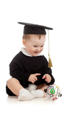 Baby in academician clothes  with Rubik Stock Photo - 11327507