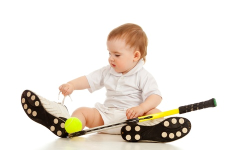 big game: adorable child floor and playing with tennis racket and ball over white background Stock Photo