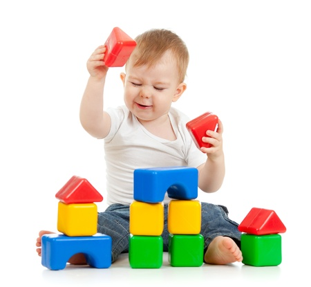little boy playing with building blocks photo