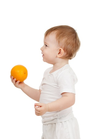child with healthy food oranges fruits photo