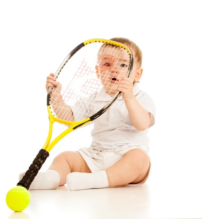 large ball: adorable child floor and playing with tennis racket and ball over white background Stock Photo