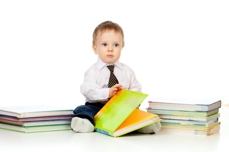 baby boy with books over white photo