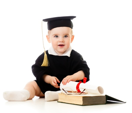 Baby in academician clothes  with roll and book photo