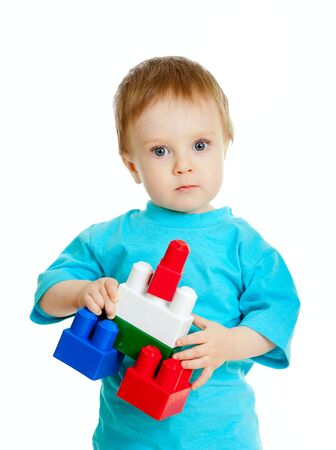 little child with construction set over white background photo