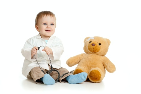 sick teddy bear: Adorable boy with clothes of doctor isolated on white