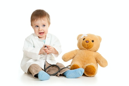 Adorable boy with clothes of doctor isolated on white Stock Photo - 11589273